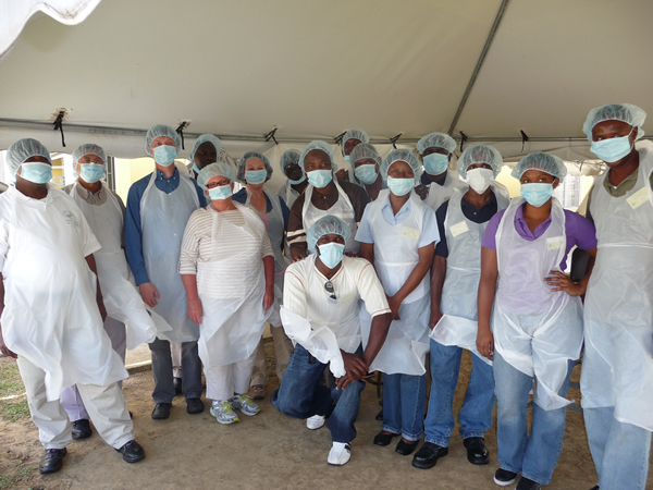 Training in Trinidad, group visit to view cassava processing