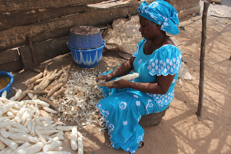 Lady peeling cassava. Photo: Lora Forsythe