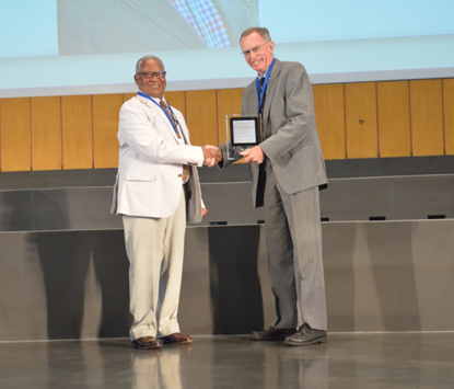 Prof Youdeowei receiving the IPPAD Award from Professor Geoff Norton, President of the International Association of Plant Protection Sciences in Berlin, Germany, August 2015. Photo: IAPPS