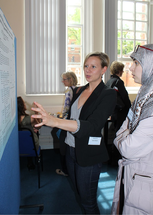 NRI PhD student, Jane Robb (left) presents her research poster to fellow student, Hajar El Hamss (right) | Photo: G Summers