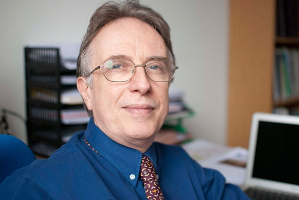 Dr John E Orchard